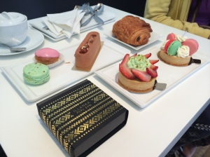 "Nadege Patisserie Part 1: Starting Top Left (Clockwise): Pistachio and Strawberry Macarons, Praline Mini Cake, Chocolate Croissant, Macaron Napoleon Cheesecake, Strawberry Pistachio Chantilly, & ""Illanka"" Peruvian Chocolate"